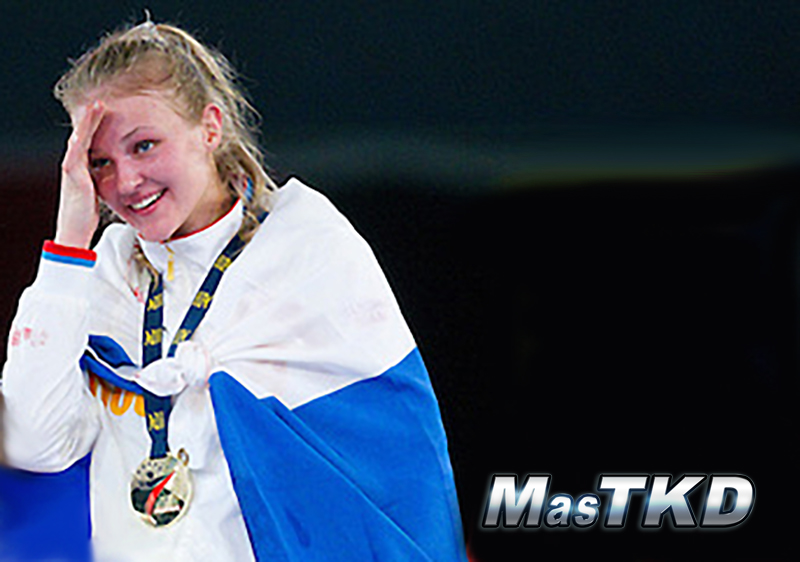 05 MAY 2012 - MANCHESTER, GBR - Anastasia Baryshnikova (RUS) of Russia celebrates her victory in the women's -73kg category final at the 2012 European Taekwondo Championships at Sportcity in Manchester, Great Britain (PHOTO (C) 2012 NIGEL FARROW)